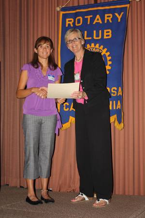 Past President Kathleen Archer presenting The Rotary Club of Santa Rosa Foundation Trustees Scholarship