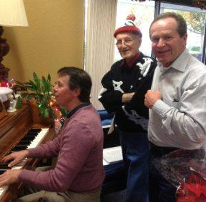 Music teacher Andy Darrow with a resident and Chip Rawson