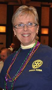 Kathleen Archer presented Bill with Mardi Gras mementoes