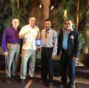 Mark Burchill, Wayne Rowlands and Vinay Patel with Rajeevalochan Dinamani of the Rotary Club of Bangalore, India