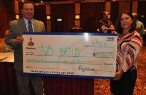 Doug Johnson with Manuela Gonzalez as she presents a check from Robobank