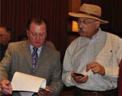 Giro Bello Director Doug Johnson signing Craig Meltzner up as a volunteer
