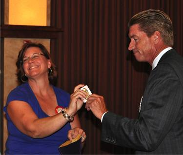 Anne Gospe looks positively gleeful as Steve Reuter registers his disappointment at not pulling the winning card