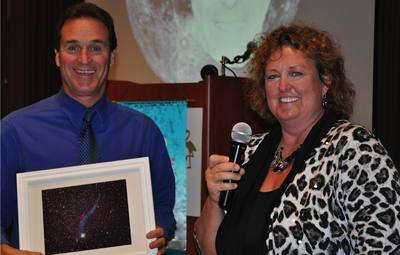 Speaker Linda Silkay presents President Bill with a photo of deep space