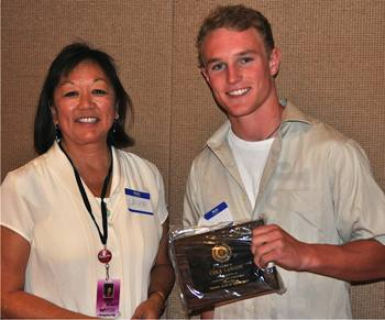 Pricipal Laurie Fong with student Cole Larson
