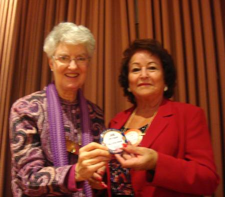 President Peggy presents Jane Duggan with her Blue Badge