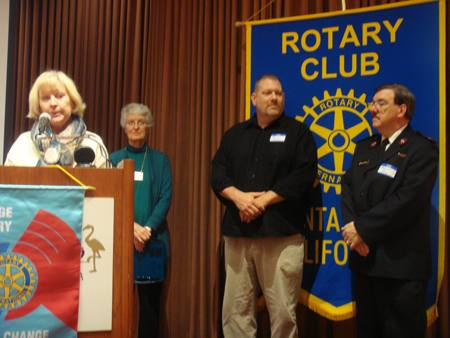 Eileen Carlisle introduces guests from the Salvation Army