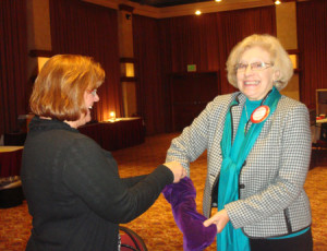 Anne Gospe offers Eunice Valentine a chance to draw the lucky card