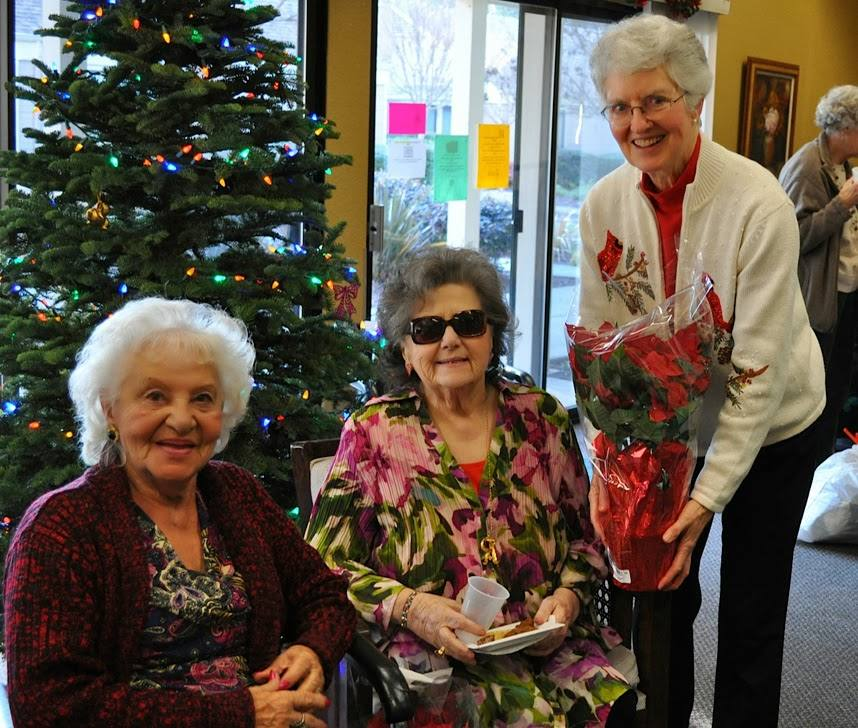 PP Peggy delivers poinsettia to guests