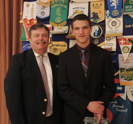 Cardinal Newman Principal Graham Rutherfors with honored student Michael Clark