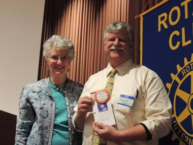 President Peggy with new Rotarian