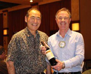 Larry Miyano and David Brown sharing their raffle prize