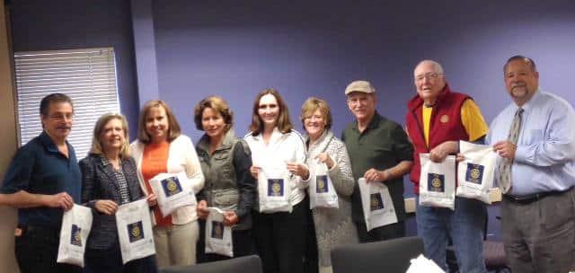 Pictured left to right are:  Dan Bornstein, Kris Anderson, Vickie Hardcastle, Kim Graves, Jackie McMillan, Kim Murphy, Robert Pierce, Dan Schell, and Jose Guillen.