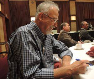 Layne Bowen contemplating who he will invite as a guest to Rotary