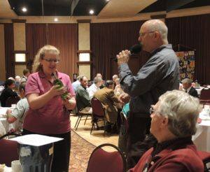 Karen Ball held the raffle number. Craig Meltzner gives the lengthy directions of what occurs next