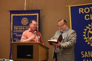 Pres Doug passes along a book to Pres Elect Jose Guillen