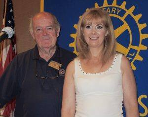 Rotarian Jack Geary presented a Blue Badge to his daughter Andrea Geary. Two generations of Rotarians in the same club!