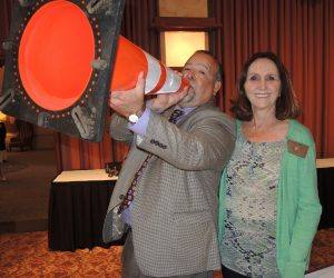 President Jose and Rotarian Jackie McMillian - Jose presented this cone to Don McMillian - absent
