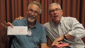 The first few raffle number drawings were for Sonoma County Fair passes. This is Rotarian Layne Bowen and Rotarian Jack Atkin fooling around. Layne had the winning number