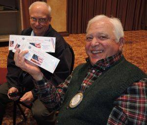 Fred Levin, co-chair of the Veterans' Day event and Paul Hamilton. The caption should serve as a reminder to buy tickets for the November 9th event.