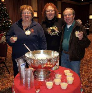 Queen Jeanne, Secretary Debi Zaft, and Chip Rawson sample some of the Rotary's traditional egg nog to celebrate the holidays!