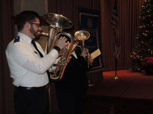 "The Salvation Army adds a musical note to the ""holiday"" meeting!"