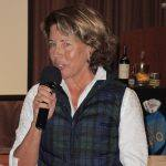 Committee Chair, Kim Graves, informs the Club of the annual Senior Christmas Poinsettia event