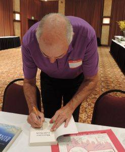Guest speaker autographing books for the Rotarians