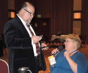 "Jose recognizes Jeanne Levin with a new badge, since she put her ""old"" badge through the wash!"