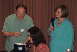 Doug Roberts calls the lucky raffle number as Cathy Vicini looks on.