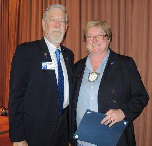 Julia Parranto is presented with her Paul Harris Society Award by past District Governor Bruce Campbell
