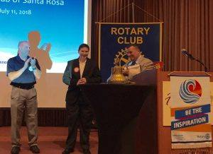 President Tony presents a Red Badge to Holly Garretson and presents a Sponsor Pin to Ray Giampoli.