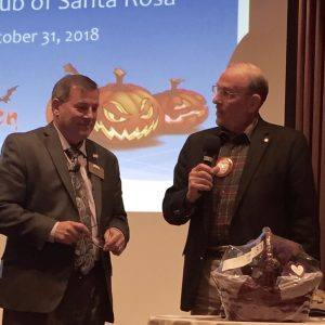 Dan Balfe presents a basket from the Foundation Dinner to President Tony who held the winning ticket.